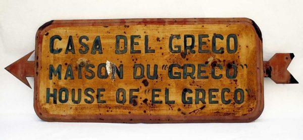 Señal metálica indicando la dirección de acceso a la Casa del Greco