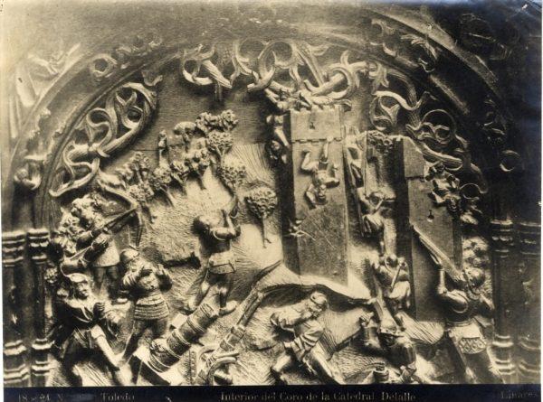 271 - Sillería baja del Coro - Escena del asalto y bombardeo de un castillo durante la Guerra de Granada